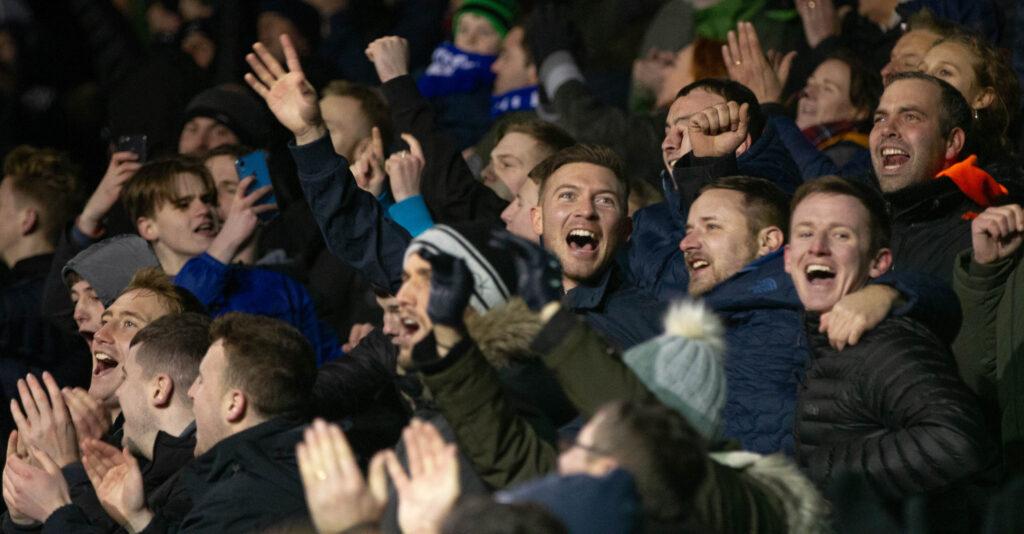 Portsmouth fans celebrating a visit to Wembley